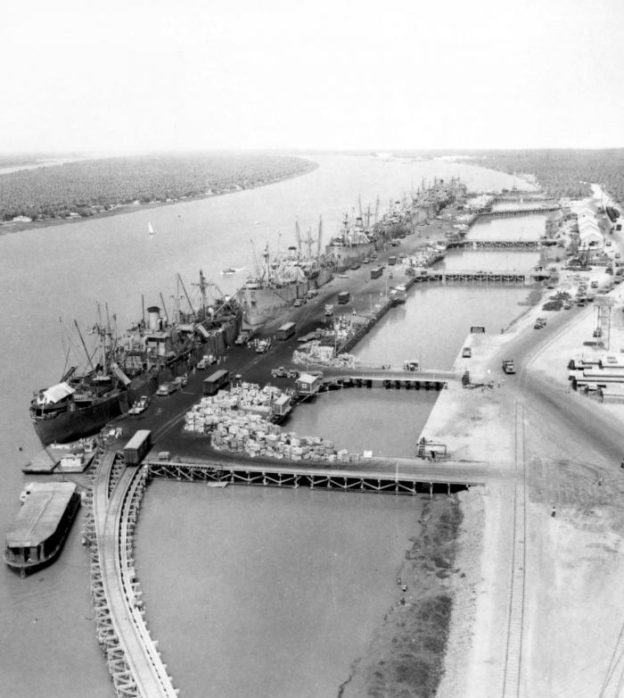 Ships unloading at the Abadan waterfront in 1942. The rail lines and some wagons are in evidence. [30]